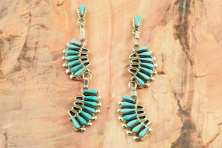 Stunning Earrings featuring Genuine Sleeping Beauty Turquoise set in Sterling Silver. Beautiful Post Earrings with Petit Point Design. The Sleeping Beauty Turquoise mine is located in Gila County, Arizona. Created by Zuni Artists Ziemund and Ethel Peina. The Zuni Pueblo is located in New Mexico, Land of Enchantment.